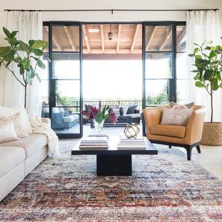 Inspiration pour une salle de séjour nordique de taille moyenne et ouverte avec un mur blanc, un sol en carrelage de porcelaine, une cheminée standard, un manteau de cheminée en béton, aucun téléviseur et un sol beige.