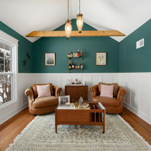Inspiration for a small timeless open concept medium tone wood floor and brown floor family room remodel in Kansas City with green walls and a bar