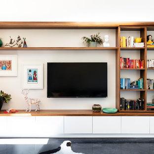 Idee per un grande soggiorno minimal aperto con pareti bianche, pavimento in cemento, parete attrezzata e pavimento nero