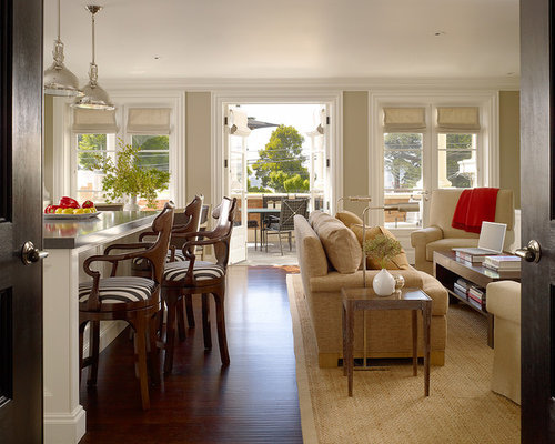 Large contemporary open concept medium tone wood floor family room idea in  San Francisco with beige