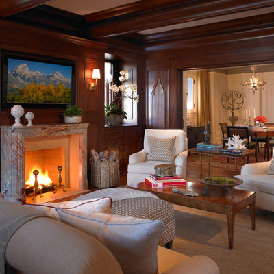 Elegant family room photo in San Francisco with brown walls, a standard fireplace and a wall-mounted tv