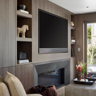 Example of a huge minimalist open concept light wood floor and beige floor family room library design in San Francisco with a media wall, white walls, a standard fireplace and a plaster fireplace