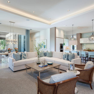 Photo of a nautical open plan family and games room in Miami with beige walls and beige floors.