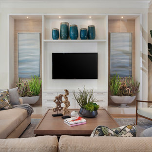 Example of a beach style open concept medium tone wood floor and brown floor family room design in Miami with beige walls and a wall-mounted tv