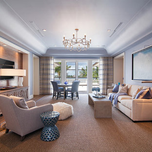 Example of a huge transitional open concept medium tone wood floor game room design in Miami with a wall-mounted tv and purple walls