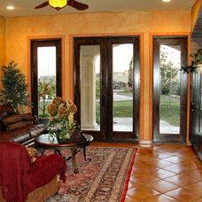 Mediterranean Family Room by Casa Terra Cotta, Inc. dba Millennium Homes