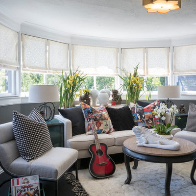 Inspiration for a transitional enclosed carpeted and black floor family room remodel in Los Angeles with a music area and gray walls