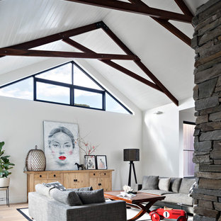 Design ideas for a contemporary family room in Melbourne with white walls, medium hardwood floors and brown floor.