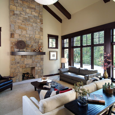 Inspiration for a timeless open concept family room remodel in Grand Rapids with beige walls, a standard fireplace and a stone fireplace