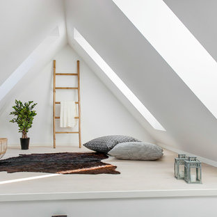 Design ideas for a mid-sized scandinavian open concept family room in Copenhagen with white walls and light hardwood floors.