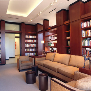 Example of a large trendy enclosed carpeted family room library design in Atlanta with brown walls, a standard fireplace and a media wall