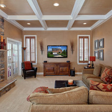 Traditional Family Room by StruXture Photography