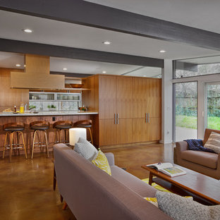 Example of a mid-sized 1960s open concept concrete floor family room design in Sacramento with a bar, white walls and a media wall