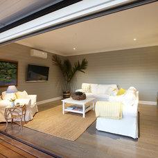 Beach Style Family Room by Acorn Garden Houses