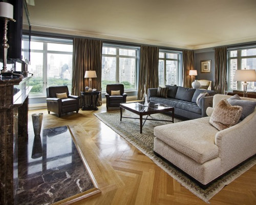 example of a classic medium tone wood floor family room design in boston with gray walls