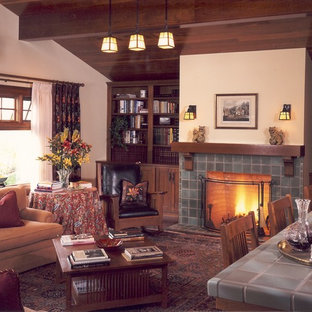 Family room - large craftsman enclosed dark wood floor and brown floor family room idea in San Diego with beige walls, a standard fireplace, a tile fireplace, a bar and no tv