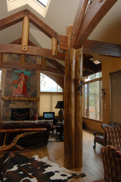 Rustic Family Room by Great Divide Builders