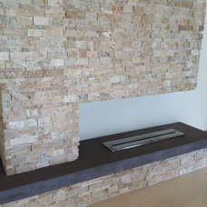 Modern Family Room by Urban Concepts Modern Fireplace Design