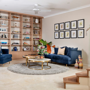 Photo of a mid-sized contemporary open concept family room in Perth with a library, beige walls, travertine floors, no tv and beige floor.