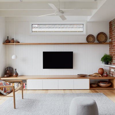 Example of a trendy open concept light wood floor family room design in Melbourne with white walls, no fireplace and a wall-mounted tv
