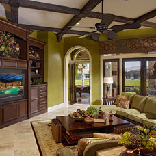 Traditional Family Room by Niemann Interiors