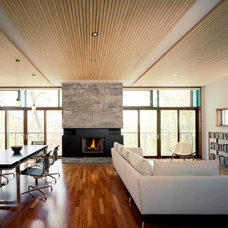 Contemporary Family Room by Arcademia Group Inc.
