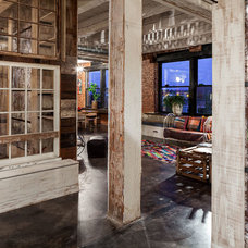 Industrial Family Room by KuDa Photography