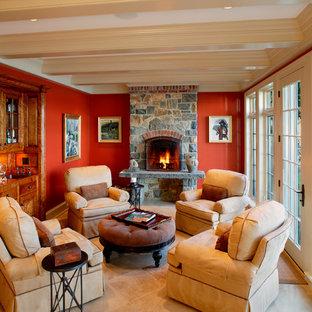 Idée de décoration pour une salle de séjour tradition fermée avec un mur orange, une cheminée standard et un manteau de cheminée en pierre.