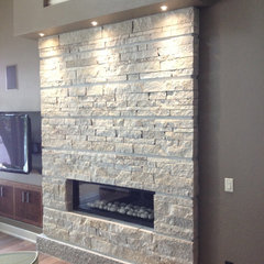 contemporary family room by Buechel Stone Corp