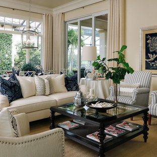 Example of a classic family room design in Miami with beige walls