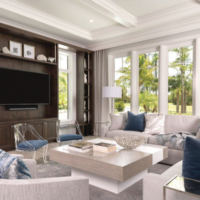 Inspiration for a mediterranean family room remodel in Miami with a media wall