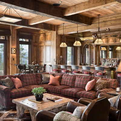 Example of a mountain style open concept family room design in Other with a bar, brown walls and no fireplace