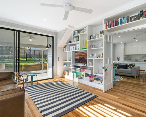 Nice Inspiration For A Transitional Enclosed Family Room In Brisbane With Dark  Hardwood Floors, A Wall