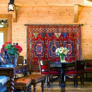 Ispirazione per un ampio soggiorno country aperto con sala giochi, pavimento in pietra calcarea, TV nascosta, pareti beige, camino classico e cornice del camino in pietra