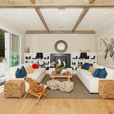 Contemporary Family Room by Core Development Group, Inc.