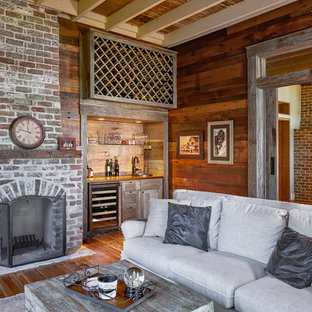Design ideas for a country enclosed family room in Atlanta with a home bar, medium hardwood floors, a standard fireplace and a brick fireplace surround.