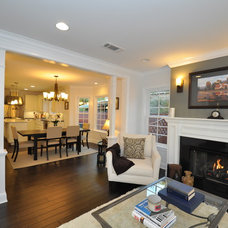 Traditional Family Room by CCForteza