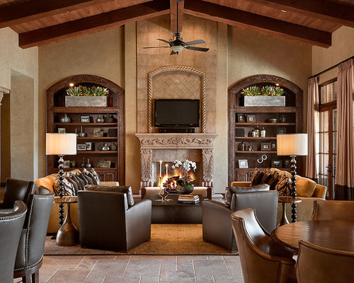 Elegant Open Concept Family Room Photo In Phoenix With A Standard Fireplace And Wall