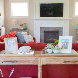 ポートランドの大きいビーチスタイルのおしゃれなオープンリビング (ベージュの壁、濃色無垢フローリング、標準型暖炉、木材の暖炉まわり、壁掛け型テレビ) の写真
