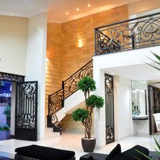Contemporary Family Room by Eric Hawawinata Architects