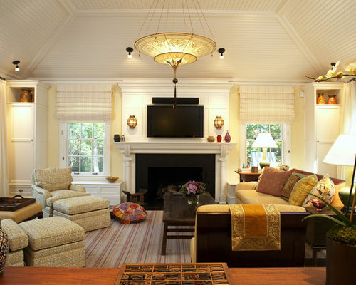 example of a trendy family room design in boston with beige walls a standard fireplace - Ceiling Light Living Room