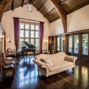 Inspiration for a timeless dark wood floor and brown floor family room remodel in Los Angeles with a music area and beige walls