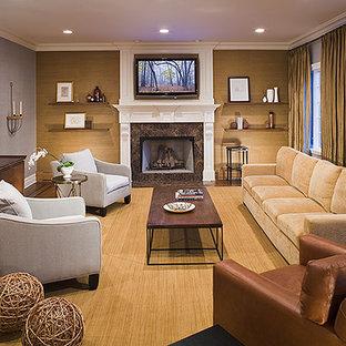 ニューヨークの大きいトランジショナルスタイルのおしゃれなファミリールーム (青い壁、濃色無垢フローリング、標準型暖炉、木材の暖炉まわり、壁掛け型テレビ、茶色い床) の写真