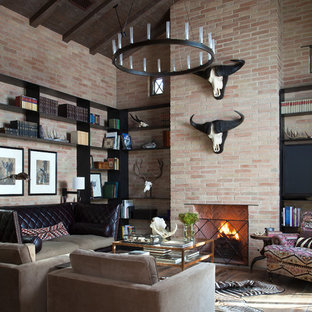 Example of a mountain style dark wood floor family room design in Austin with a standard fireplace and a brick fireplace