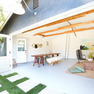 Idée de décoration pour une salle de séjour design avec béton au sol.