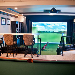 Inspiration for a large transitional enclosed carpeted game room remodel in Indianapolis with beige walls, no fireplace and a media wall
