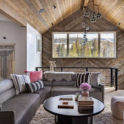 Inspiration for a rustic open concept brown floor and medium tone wood floor family room remodel in Los Angeles with white walls and no fireplace