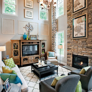 Inspiration for a transitional open concept family room remodel in Chicago with beige walls, a standard fireplace, a stone fireplace and a tv stand