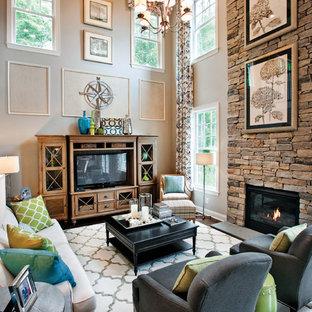 Exemple d'une salle de séjour chic ouverte avec un mur beige, une cheminée standard, un manteau de cheminée en pierre et un téléviseur indépendant.