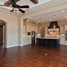Traditional Family Room by Joseph Paul Homes